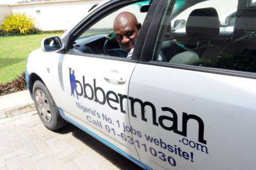 A man backs up a car belonging to the Nigerian job-finder site Jobberman, on June 17, 2013, in the Lagos suburb of Lekki