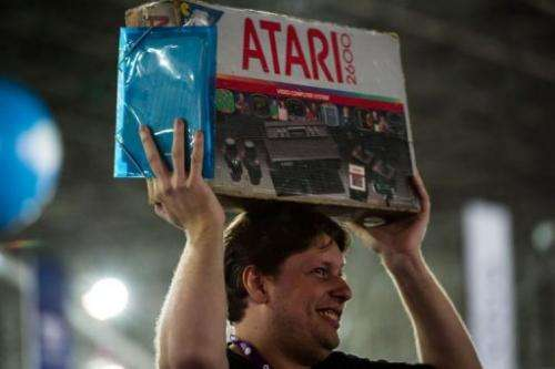 A man carries a box with an Atari game in Sao Paulo, Brazil, on January 30, 2013