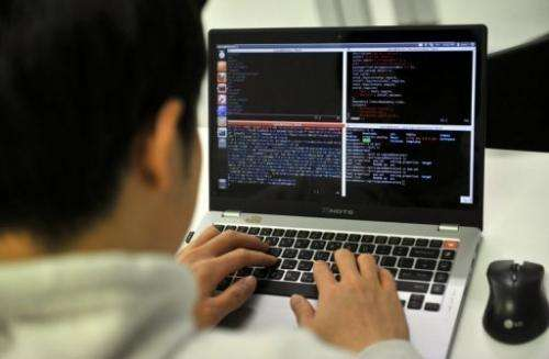 A man studies internet security at the Korea Information Technology Research Institute in Seoul, February 14, 2013