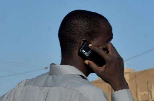 A man uses his telephone on a market place in Agadez, northern Niger, on September 26, 2010