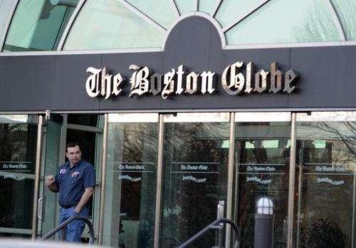 A man walks out of The Boston Globe on February 20, 2013 in Boston, Massachusetts