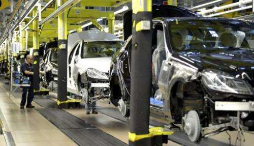 A man works in the Mercedes-Benz factory of the Daimler AG in Sindelfingen, Germany, on February 5, 2013