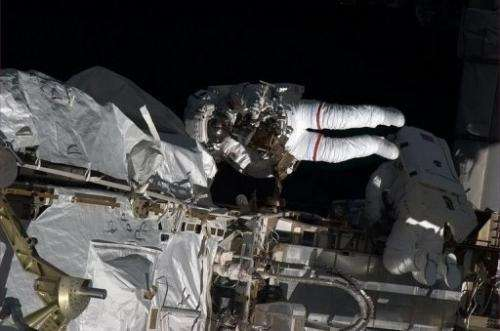 A May 11, 2013, image from the ISS shows astronauts Tom Marshburn and Chris Cassidy during a spacewalk to make repairs