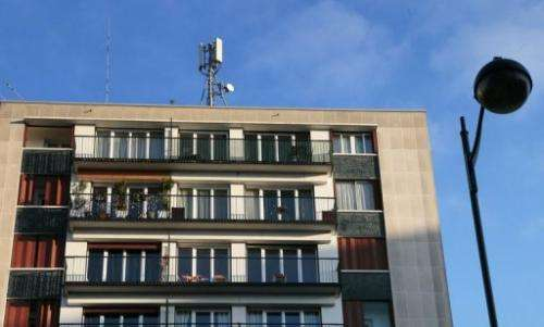 A mobile phone mast on the rooftop of a residential building in Paris, December 10, 2012