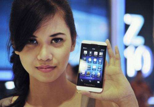 A model holds the BlackBerry Z10 in Jakarta on March 15, 2013