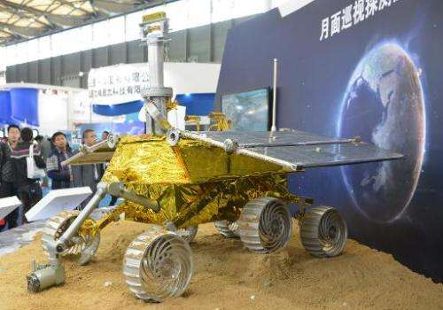 A model of China's lunar rover known as The Yutu, or Jade Rabbit is put on display at the China International Industry Fair 2013