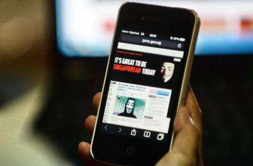 An activist claiming to be from hacker group Anonymous is seen on the website of Singapore's government, on November 7, 2013