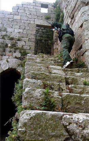 An AFPTV frame shows a Syrian rebel taking position at the Crac des Chevaliers on the outskirts of Homs on June 28, 2012