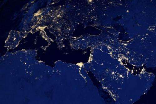 A NASA image obtained December 6, 2012 shows city lights in part of Europe, North Africa and the Middle East at night