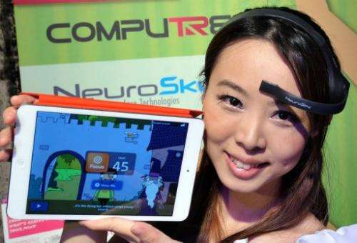 "A NeuroSky brainwave starter kit, ""MindWave Mobile,"" seen during a press conference in Taipei, on May 28, 2013"
