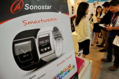 A new smartwatch, developed for golfers, is shown to visitors during Computex fair in Taipei, on June 5, 2013