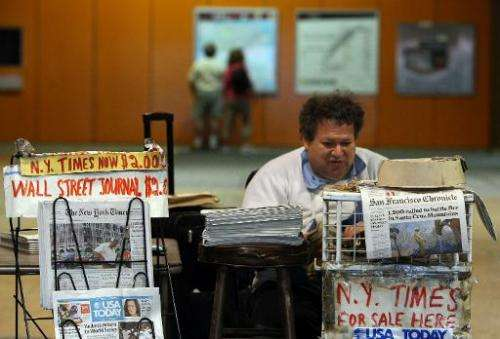 A newspaper vendor waits for customers at his stand in an underground rail station October 26, 2009 in San Francisco, California