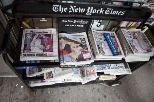 A newsstand displays newspapers in New York City on April 30, 2011