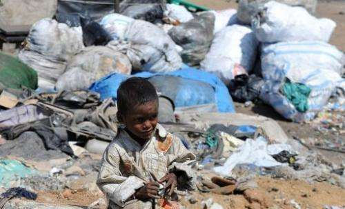 An Indian child plays in a slum on the outskirts of Hyderabad on June 5, 2012