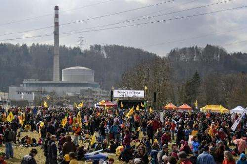 Anti-nuclear activists gather in front of the Muehleberg nuclear plant on March 11, 2012