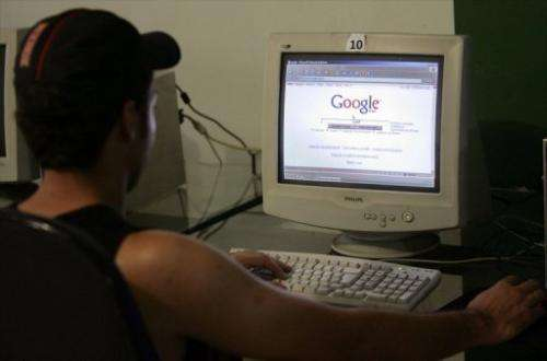 An user checks Google at a cybercafe in Brasilia, on April 9, 2008