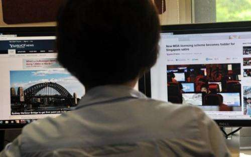 A person browses media websites in Singapore, on May 30, 2013