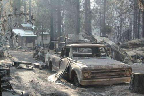 A pick-up truck and buildings destroyed by the Rim Fire, August 28, 2013