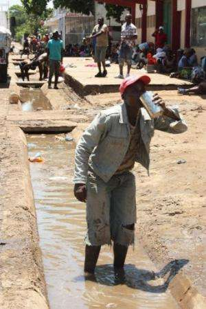 A resident of flood-hit Chokwe drinks drain water on January 27, 2013