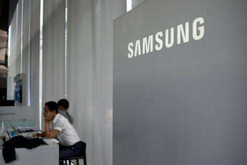 A Samsung logo is displayed at a showroom in Seoul on July 5, 2013