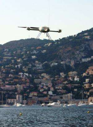 A self or remote-guided drone overflies a beach in Saint-Jean-Cap-Ferrat & Villefranche harbour, France, July 30, 2009