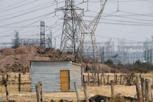 A shack without electricity underneath power lines in Marikana, South Africa, on August 28, 2012