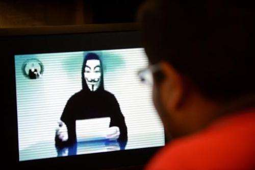 A spokesman for Anonymous issues a warning through a video posted online, on November 1, 2013