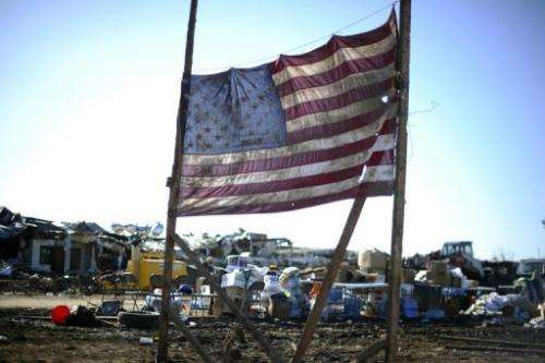 A US flag is displayed amongst the debris of the tornado devastated school on May 22, 2013 in Moore, Oklahoma
