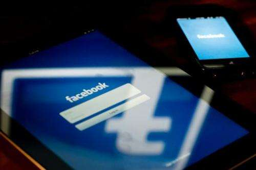 A view of a tablet and a smartphone displaying the Facebook app's splash screen on May 10, 2012 in Washington, DC