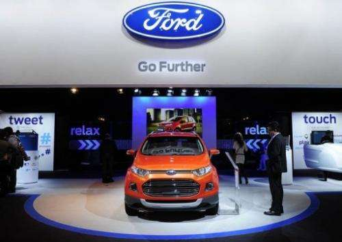 A visitor looks at a Ford B-Max car at the 2013 Mobile World Congress in Barcelona on February 27, 2013