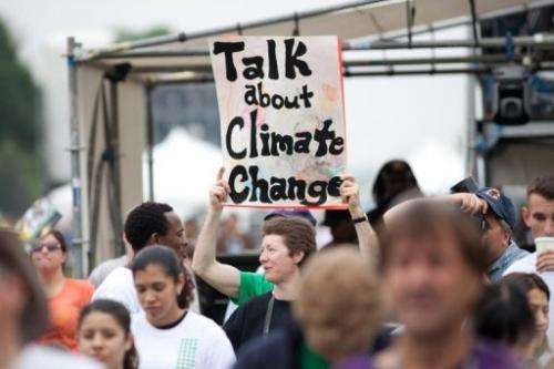A woman holds a sign advocating more attention for climate change at a rally on April 25, 2010 in Washington, DC