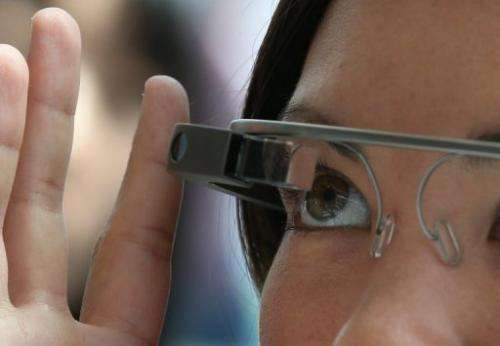 A woman tries Google Glass during the Google I/O developer conference on May 17, 2013