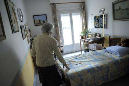 A woman walks in her room on March 18, 2011 in Angervilliers, eastern France.