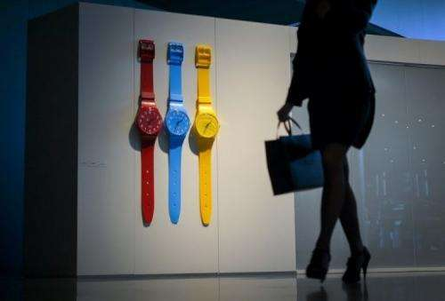 A woman walks through the booth of Swiss watchmaker Swatch on the opening day of watch fair Baselworld on April 25, 2013