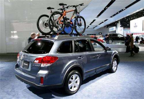 Bikes share space with cars at Detroit auto show
