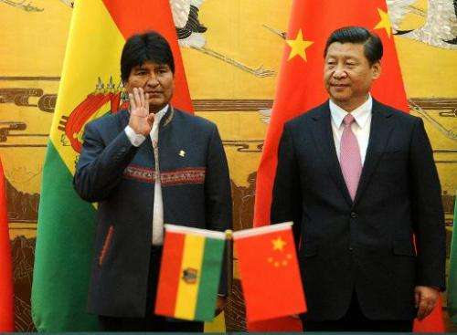Bolivian President Evo Morales (L) reacts as he attends a signing ceremony with Chinese President Xi Jinping at the Great Hall o