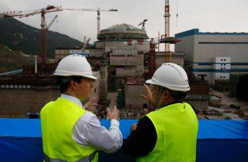Chancellor George Osborne (left) talks with Taishan Nuclear Power Joint Venture general manager Guo Liming at a nuclear power pl