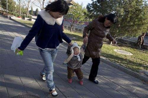 China: Birth limits still needed despite easing