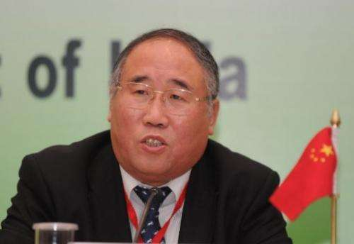 China's top climate negotiator Xie Zhenhua addresses a press conference in New Delhi on February 14, 2011