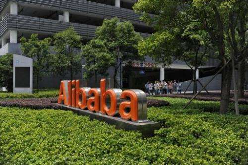 Chinese workers walk out of the Alibaba head office building in Hangzhou, in  China's Zhejiang province on May 21, 2012