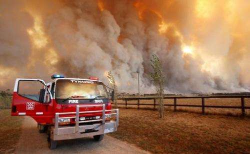 Country Fire Authority (CFA) staff monitor a giant fire raging in the Bunyip State Park, on February 7, 2009