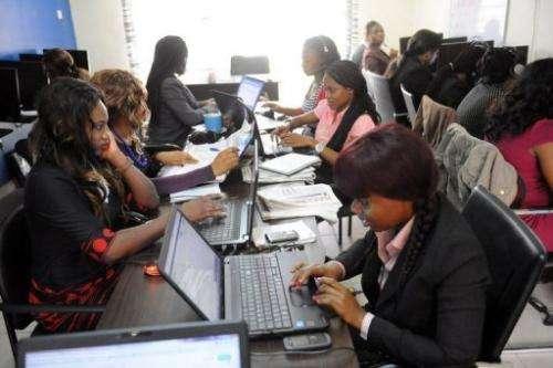 Customer care emloyees of the Nigerian job-finder site Jobberman work on June 17, 2013 in the Lagos suburb of Lekki