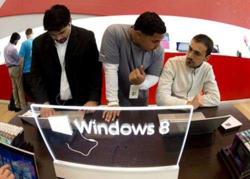 Customers get a look at products at Microsoft's pop-up store on October 26, 2012 in New York