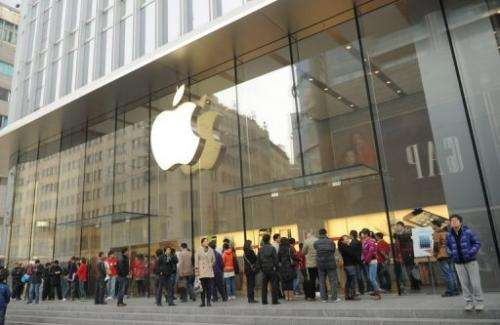 "Customers wait for an Apple store to open as = the new ""iPad mini"" goes on sale in Shanghai on December 7, 2012"