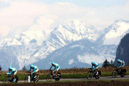 Cyclists ride through mountains in the Giro del Trentino in Lienz on April 16, 2013