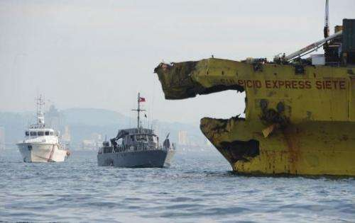 Damaged cargo ship seen on August 17, 2013 after it collided with the ferry St. Thomas Aquinas