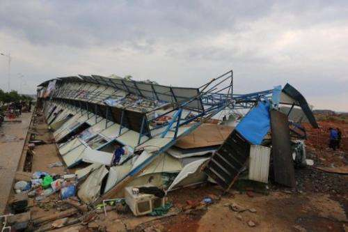 Damaged houses are shown after a tornado hit Yongzhou, in central China's Hunan province, March 20, 2013