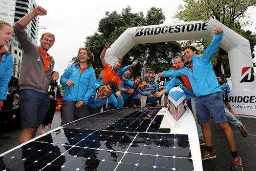 Dutch team Nuon from the Delft University of Technology celebrate after crossing the finish line in an epic 3,000-kilometre (1,8