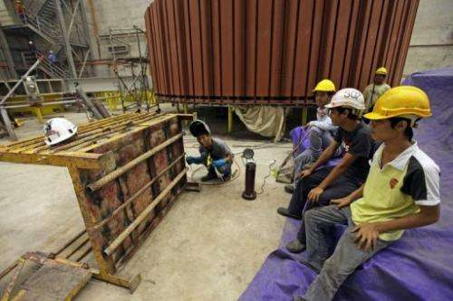 Employees working on the power house at the Bakun dam on September 21, 2011