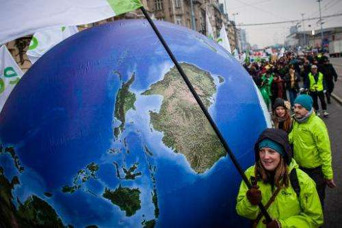 Enviromental activists march demanding more climate saving actions during UN climate change talks on November 16, 2013